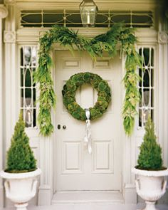 natural holiday style doorstep decor with natural greens and moss