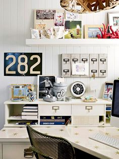 Vintage accesories add character to an at-home office. See the rest of this colorful home: http://www.bhg.com/decorating/decorating-style/modern/do-it-yourself-eclectic-makeover/?socsrc=bhgpin041413cottagedesk=14