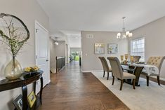 This new construction ranch-style home in Columbia, IL is perfect for young couples or empty-nesters. Home Staging Companies, Young Couples, Ranch Style, New Construction, St Louis, Empty, Columbia, Table, Room