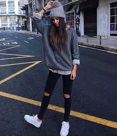 Puma creepers, cigarette ripped skinny jeans, button down and sweater, Pom beanie