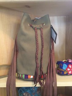 Sage green leather drawstring pouch handbag with fringe detail - SOLD.