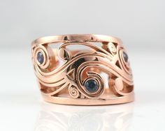 Mens band in 14k rose gold with blue sapphires