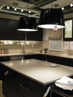 Ikea Kitchen - like the dark cabinetry and super light counters