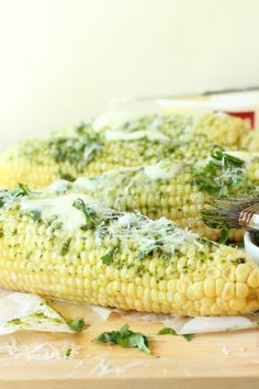 Juicy tender ears of sweet corn are covered in chimichurri sauce and drenched in butter. The perfect side for a barbecue or pot luck party!