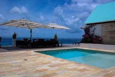 Overlooking the infinite blues of the Caribbean sea, this 5 bedroom vacation villa is the perfect holiday retreat Caribbean Sea, Vacation Villas, Infinite, Blues, Bedroom, Outdoor Decor, Holiday, Home Decor, Vacations