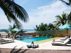Karmairi Hotel & Spa in Cartagena, Colombia, is an intimate 14-room beach resort and spa hidden down a dirt path in the fishing village of Manzanillo del Mar, 15 minutes by taxi north of Cartagena's old walled city.