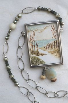 White Sand Dunes collagraph print set in hand crafted jewelry. Sterling silver and amazonite, jade and fresh water pearls. emenlu.com