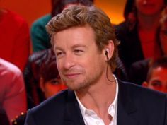 """Simon listening to the interpreter [through ear piece) during an interview on a popular French TV program, during the """"I'll Give It a Year"""" promotion."""