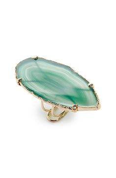 A flat agate stone adds rich color to a sleek goldtone ring that is a stunning statement accessory.