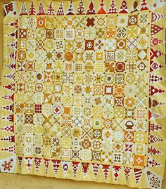 Dear Jane quilt...love the colors  LIKE: yellow/red  very well balanced colors   love red border