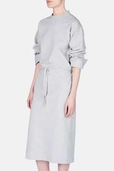 """Founded by seven graduates of Antwerp's Royal Academy of Fine Arts, Vetements aspires to create """"fashion that has a place in the real world,"""" says head designer Demna Gvasalia. Rooted in deconstruction and boundary-pushing reconstruction, the creative collective's singular pieces include this slouchy dress: an exaggerated and extended take on the classic grey sweatshirt."""