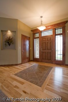 Like the ceramic tile inlay in foyer.