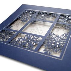The Christmas card is made of high quality dark blue paper. The dark blue cover has laser cut stars in a window. There are hot stamp sliver foil decorative elements on the cover. The insert is white. The front side of the insert has a silver-printed design that gives a background for the stars.The envelope is included.