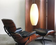 Herman Miller 2010 production of the classic Eames Lounge Chair and Ottoman in Palisander and leather.