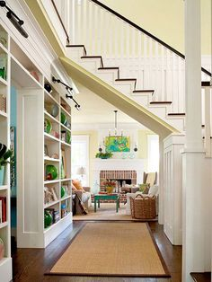 Consider Every Angle.This classically appointed staircase optimizes limited foyer space by taking a few unconventional turns. Strategically placed landings allow the staircase to switch directions before its final flight rises to create a vaulted-ceiling doorway opening to the family room. Built-in bookcases stand in as an opposing wall that expands the entry hall's purpose.