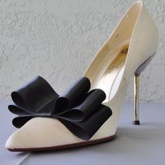 Detachable Black Satin Ribbon Bows Shoe Clips Beautiful and very chic satin ribbon bow to add some glamour to any basic pair of shoes. They are removable and won't damage your shoes. It can be attach at front or at the back of the shoe.  The listing is only for a set of two ribbon bows the shoes are only to showcase the clips. Accessories