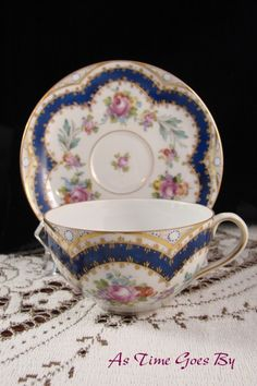 Delicate and oh, so pretty! This cup and saucer are paper thin. We can see the marks on the bottom THROUGH the inside when we hold them up to a light!