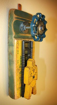 Coat Rack Wall Hanger Garden Faucet Handle Yellow Yardstick Ruler Bill Ding Wooden Figure Repurposed Upcycled Recycled Baseboard No. 17. $49.00, via Etsy.