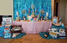 A LITTLE MERMAID dessert table filled with yummy goodies, pearls, gold and a sunken treasure.