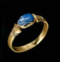Gold bracelet from the Tomb of Shoshenq II (r. 887-885 B.C.) mounted with a lapis lazuli scarab,from Tanis.3rd Intermediate,22nd Dynasty.