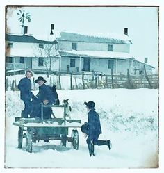 Retrieving a hat, Amish boy runs to catch horse drawn wagon with boys and dog aboard.