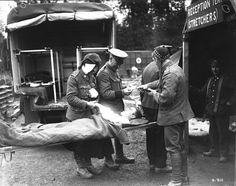 WWI, Oct 1916; A wounded soldier is being transferred from a motorized ambulance to a Casualtie Clearing Station. -canadasmilitaryhist (@CanadasMilHist) | Twitter
