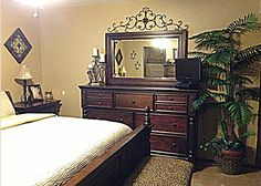 Bedroom decor ideas Tall dresser.. Master Bedroom Decor Brown accents