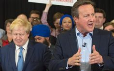 London Mayor Boris Johnson grimaces as David Cameron, standing to his left and…