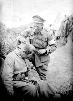 Major DJ Glasfurd (later Brigadier General), having his hair cut by Major ES Stokes who is smoking a pipe. On 12 November 1916 Brigadier General Glasfurd was mortally wounded at 'Cheese Road', in France, while commanding the 12th Australian Infantry...