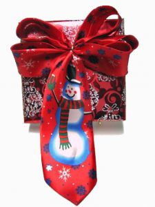 Wrapping Ideas: Dollar Store Neck Ties - an extensive array of Christmas gift wrapping ideas and tutorials. The Dollar Store has some very festive inexpensive holiday neck ties.  For only a dollar you can purchase a tie decorated with a snowman, Santa Claus, and other holiday designs.  The Dollar Store's cheap ties are the perfect bow material to use for creative holiday gift wrapping!