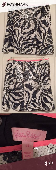 Gorgeous Lilly Pulitzer sequin skirt Lilly Pulitzer black and white zebra print sequin skirt. Top of skirt has hot pink trim. Re-posh - bought from someone who wore it once but sadly it doesn't fit me right. Super cute and fun for parties or going out. Size 14 Lilly Pulitzer Skirts Mini