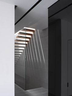 Light pouring through an open staircase. Herzelia Pituah House by Israelean architect Pitsou Kedem and Tanju Ozelgin.