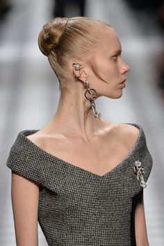 Razor sharp profiles and elaborate ear pin details give a regal vibe at @BALENCIAGA #PFW #AW15