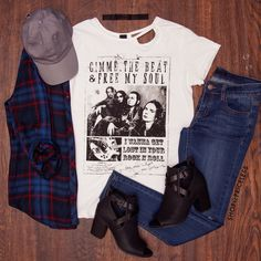 - Details - Size Guide - Model Stats - Contact Get lost in the rock and roll with this Gimme The Beat Band Tee! Features a lightweight, knit fabric with stretch. Scoop neck front with cut-out detail a