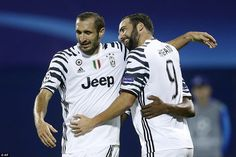 Giorgio Chiellini joins in the celebrations with Higuain, who scored Juventus's second goal of the night