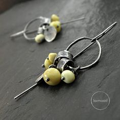 Earrings are totally made of oxidized silver 925 and Baltic amber  Dimensions: Earrings total length: 2 inches / 5 cm. Single earrings weight: 4,5