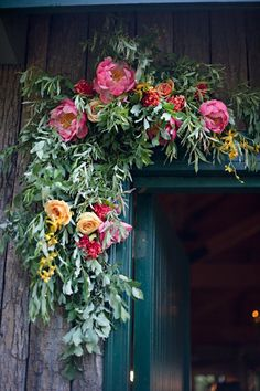 from bohemian homes on tumblr - flowers above a door