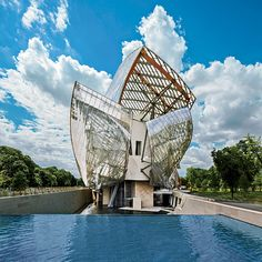 The latest must-see attraction in Paris floats like a cloud of glass above the treetops of the ...
