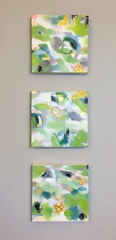 Abstract triptych inspired by lily pads and koi ponds. These three pieces function beautifully stacked together or arranged around a room. Subtle warm and cool hues seemingly rise and fall on the surface of the canvas, suggesting movement and making these paintings easy to match with existing decor.