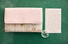 Mid-Century Modern Art Wedding Inspiration - Great pattern on this pale pink, off white, and brown clutch.