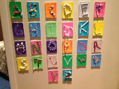 Reggio Emilia: The Alphabet   The letters of the alphabet created using found objects and materials on a painted surface.  You could use canvas boards, foam core or heavy paper.