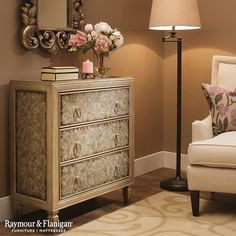 Add a beautiful accent to your home with this Gretchen 3-drawer chest. Its flowing silver flower scroll design is accented with shiny silver ring pulls and tapered feet for a timeless look. Beveled glass panels cover the drawer fronts, side panels and top for added appeal.