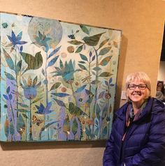 Sue Davis with her painting at Artlink's regional exhibition in Fort Wayne Indiana