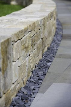 What I like: love this French drain and retaining wall idea for the backyard. Also keeps with the tan and gray color scheme. Landscaping With Rocks, Backyard Landscaping, Landscaping Retaining Walls, Landscaping Ideas, Modern Patio Design, Stone Retaining Wall, Patio Stone, Brick Pavers, Stone Wall Design