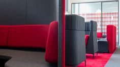 Striking office pod seating areas. Grey & red. Interior office design by Interaction for Burges Salmon Law Firm in Bristol, UK.