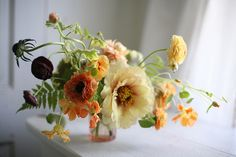 No matter what, around the home say it with flowers... Photo via Amy Merrick's 'An Apple a Day' blog.