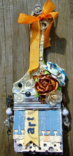 Altered paint brush by Jen Matott using new Craftsman collection by Prima