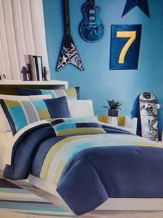 12 Year Old Boys Bedroom Ideas With Blue Striped Bed And A Scateboard In  Wooden Floor