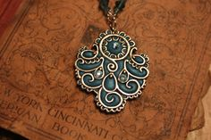 Sculpey Polymer clay and silver pendant idea by Niki Meiners