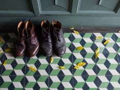 Gaby Dellal, London home renovation, black, green, white encaustic cement tiles in entry hall, breakfast green wood panels, Remodelista